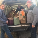 Unloading the Scott's Corner's The Market at Pound Ridge Square van. Billy Fortin lent his van which carried over 100 bags to CCNW. Gerald and Guy make light work of unloading it.